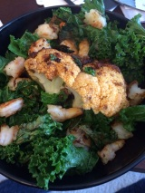 Curry Roasted Cauliflower Head with Sautéed Shrimp & Kale
